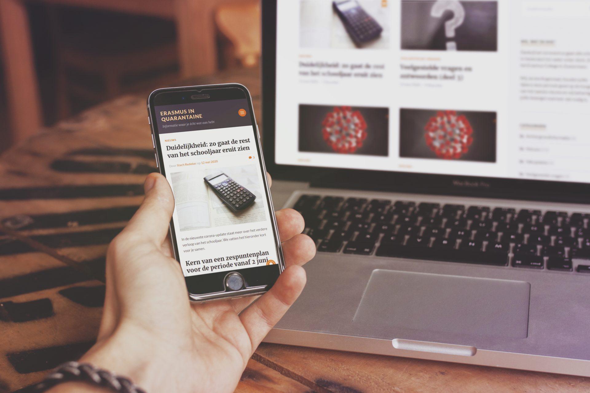 Erasmus in quarantaine; op de foto is de site zowel op een telefoon als een laptop zichtbaar